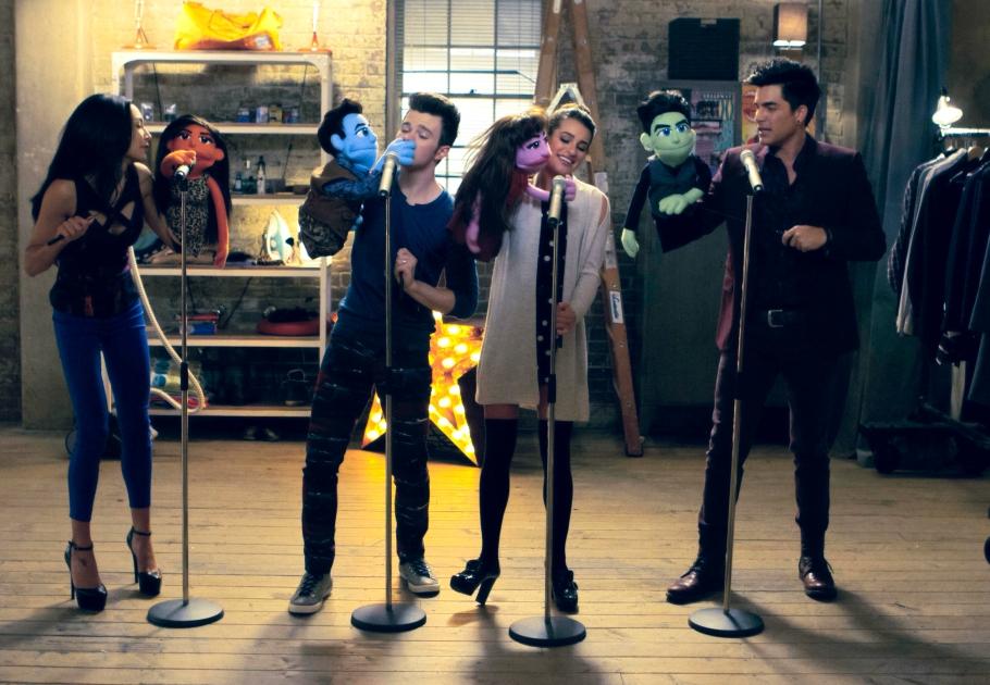 Santana, Kurt, Rachel, Elliott (Naya, Chris, Lea, and Adam) with their puppets in Glee Puppet Master